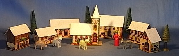 Early German cardboard Christmas village, before electric lighting.