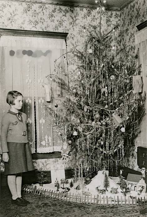1930s girl with Christmas tree & putz - Vintage Christmas Photographs From The 1930s.